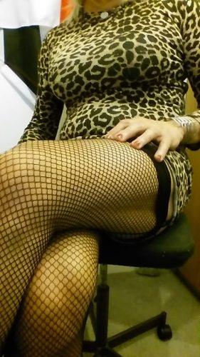 Long Blonde cross legged