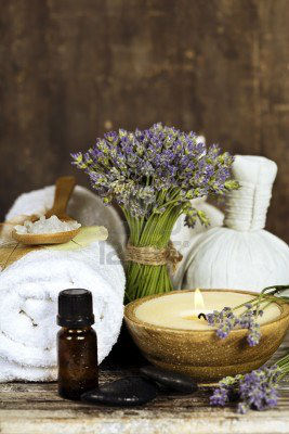 14884949-fresh-lavender-flowers-zen-stones-essential-oil-candle-herbal-massage-balls-and-towel-over-wooden-su